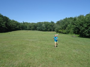 My oldest daughter, bounding across Robert Frost's fields in New Hampshire