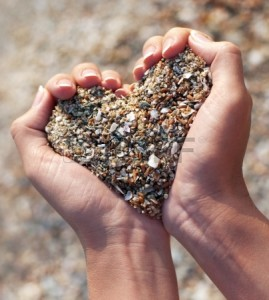 18488283-hands-holding-a-sand-in-form-of-the-heart