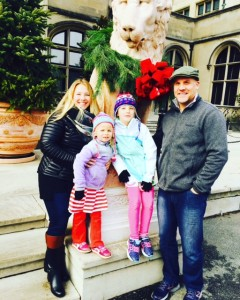 My family, with one of the lions flanking the front doors at Biltmore.