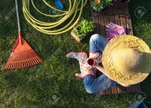 51112379-woman-having-a-coffee-break-while-working-in-the-garden