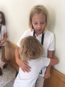 Little sister hugging big sister goodbye